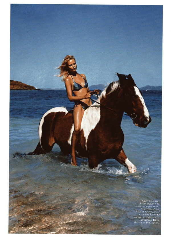 Natasha Poly on a horse by Mario Sorrenti in Plage Privée Vogue Paris May 2010