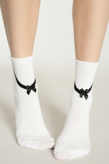 white Tuxedo Bow socks from Urban Outfitters