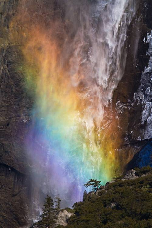 a rainbow up in the mountains picture image