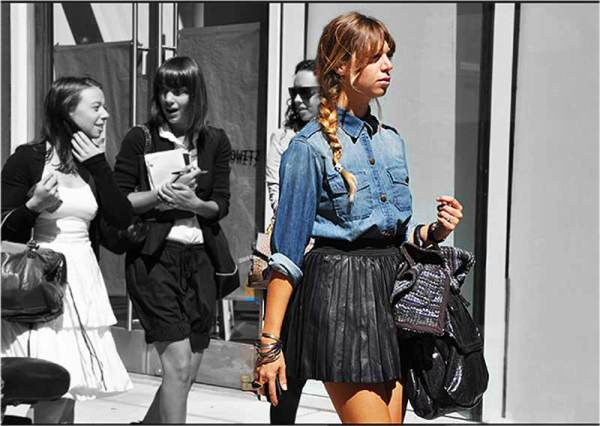 Photographed by Tommy Ton, girl in denim shirt and clack leather mini skirt, fashion trends, 2010,