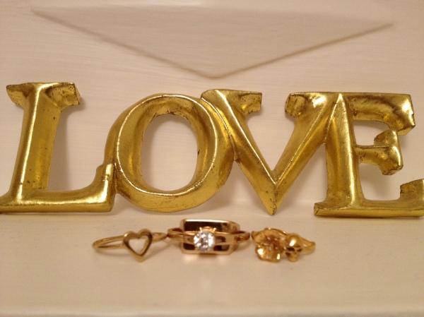 Gold heart ring - Whistles, Brass engagement ring - Maison Martin Mergiela, Gold skull & flower ring - Zoe and Morgan