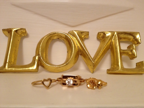Gold heart ring - Whistles, Brass engagement ring - Maison Martin Mergiela, Gold skull & flower ring - Zoe and Morgan