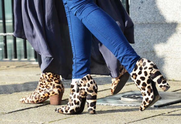 Leopard print boots out and about at London Fashion Week photographed by Tommy Ton